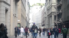 Croud of people in center of Milan walking looking in showcase shop - spring day Stock Footage