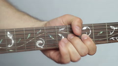 Play solo electric guitar with his left hand on the fretboard - stock footage