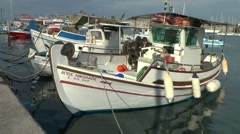 Traditional Greek fishing boats in the harbor - stock footage