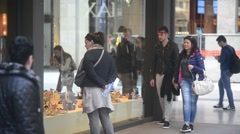 Shopping in Milan, people pedestrian walking looking in showcase shoes Stock Footage