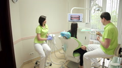 Dentist talking to a patient in medical office Stock Footage