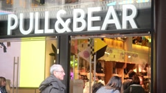 Shopping in Milan, Visitors come to the store of clothes Pull&Bear Stock Footage