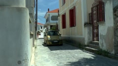 Narrow street of Greek coastal town Stock Footage