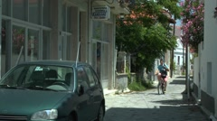 Narrow street of Greek coastal town Stock Footage