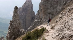 Man admires the rocky formation in the mountains Stock Footage