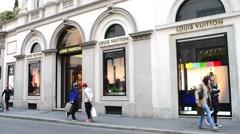 Shopping in Milan, Monte Napoleone, showcase of Louis Vuitton Stock Footage