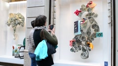 Shopping in Milan, Monte Napoleone, pedestrian watching showcases Stock Footage