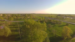 Green summer park. Sunset. Aerial footage. Camera aorund. - stock footage
