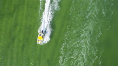 Overhead Aerial Fun Recreation Speed Boats in Ocean Lagoon Stock Footage