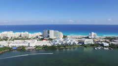 Aerial of Lagoon Caribbean Ocean Showing Boats Cancun Resorts Hotels and Beach Stock Footage