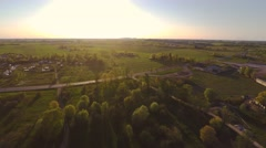 Green fields in summer park. Sunset. Aerial footage. Stock Footage