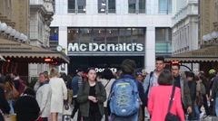 Mc Donalds fast food signboard in Milan people tourists crowd walking Stock Footage
