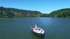 4K Aerial drone shot San Francisco Lake blond girl boat high wind Arkistovideo