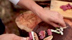 Assembling beef kebabs Stock Footage