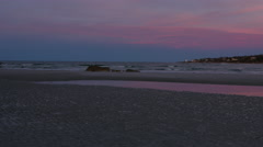Colorful sunset on beach in Gloucester, MA Stock Footage