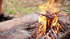 Building wood fire in fire pit Stock Footage