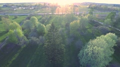 Green summer park. Sunset. Aerial footage. - stock footage