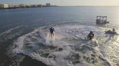 Overhead aerial of man and water Jetpack with jet skis Stock Footage
