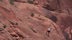 Repelling down, Moab, Utah rock climber Stock Footage
