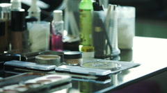 Makeup artist using cosmetics products on table Stock Footage