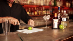 Bartender slicing lime for cocktail Stock Footage
