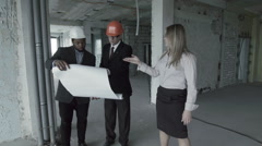 Man, woman, african american in suit and hard hat consider blueprint inside Stock Footage