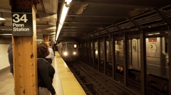 Subway train arriving at platform in Penn Station, New York City, New York, USA Stock Footage
