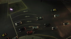 Cars passing through traffic circle Stock Footage