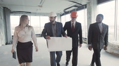 Men, woman in suit, hard hat move, communicate and discuss. Three white, one Stock Footage