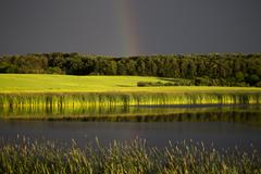 Storm Clouds Prairie Sky Rainbow - stock photo