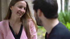 Couple talking and laughing together Stock Footage
