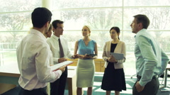 Business team wrapping up meeting Stock Footage