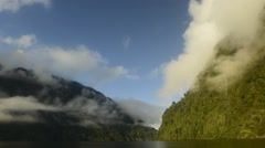 Fjord and lushly forested mountains in Patagonia, South America Stock Footage