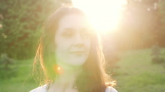 Woman at sunset straightens hair. Slow motion Stock Footage