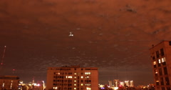 Overcast sky over city at night Stock Footage
