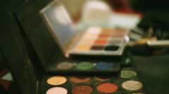 Make up designer put brush in brown bright eye shadows. Professional cosmetic - stock footage