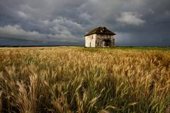 Storm Clouds Prairie Sky Stone House - stock photo
