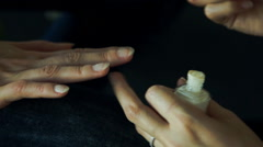 Woman getting fingernails painted - stock footage