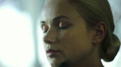 Makeup artist applying face powder on women's face Stock Footage