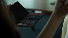 Woman holding eyeshadow palette - stock footage