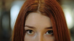 It is a view of beautiful young woman eyes of green color sitting in front of Stock Footage