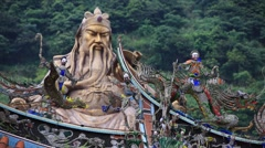 Stautue of Guan Yu behind delicate wooden sculptures at Taiwan Confucian Temple Stock Footage