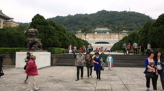 Time lapse of tourists visiting and taking photos in front of Taiwan museum Stock Footage