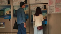 Young couple buying subway tickets at ticket machine in the MRT station Taipei Stock Footage