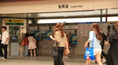 People buying subway tickets at the ticket machine in the MRT station Taipei dow Stock Footage