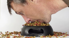 Man Eating Pet Food From Dish - stock footage