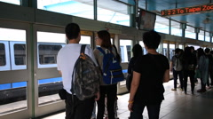 Time lapse of passengers getting on and off on the platform of Taipei MRT subway Stock Footage