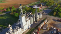 Aerial flyover of midwest grain elevator, early morning Stock Footage