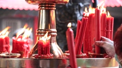 Red candles burning at the Lungshan Temple in Taipei Stock Footage