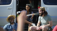 4K Hipster group with camper van having fun at music festival campsite Stock Footage